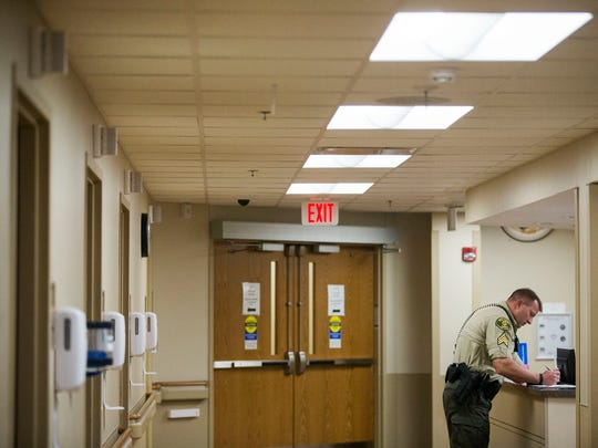 Polk County sheriff's Sgt. Jeff Rullman fills out paperwork after bringing two people in mental-health crisis into Broadlawns Medical Center on Wednesday, April 25, 2018, in Des Moines. Rullman leads a team of four sheriff's deputies who are tasked with finding people who have been given court-ordered mental-health assessments and getting them to the hospital.