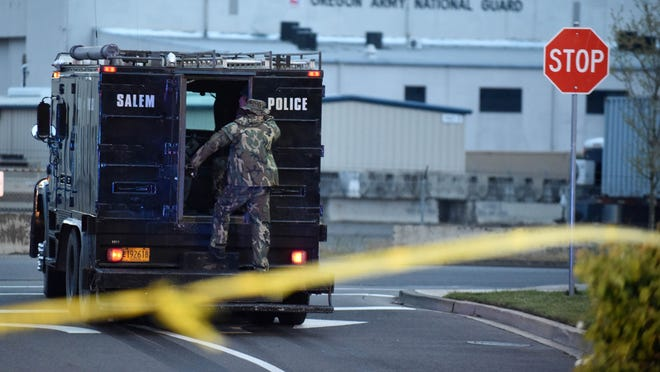 Police begin to leave the scene after a shootout and standoff April 24 in the Wal-Mart parking lot along Turner Road in Salem.