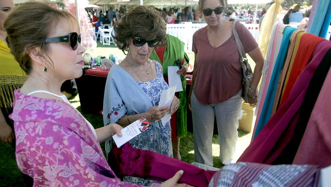 In this file photo, Emma Montes, Dee Geverink and Barbara Post, from left, look at rebozos for sale during a past Rebozo Festival at the Camarillo Ranch House.