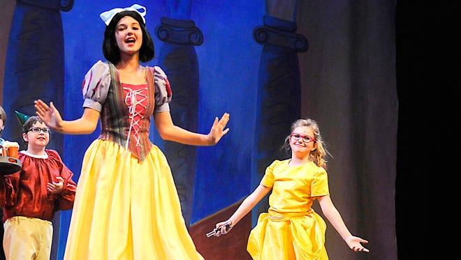 """Rebecca Morris, as Snow White, runs through a dress rehearsal of """"Snow White and the Seven Dwarfs"""" performed by the GREAT Theatre on Wednesday at the Paramount Theatre."""