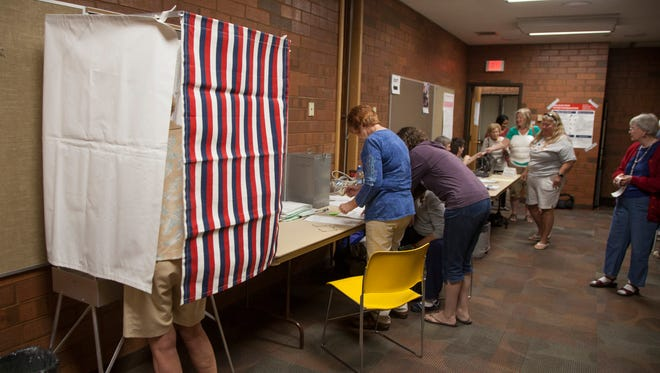 St. George residents vote early at the St. George City Office Tuesday, Oct. 25, 2016.