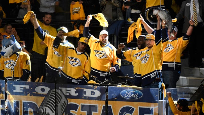 Marcus Mariota, second from left, and other Titans players cheer at the beginning of game 3 of the Western Conference finals at Bridgestone Arena Tuesday, May 16, 2017 in Nashville, Tenn.
