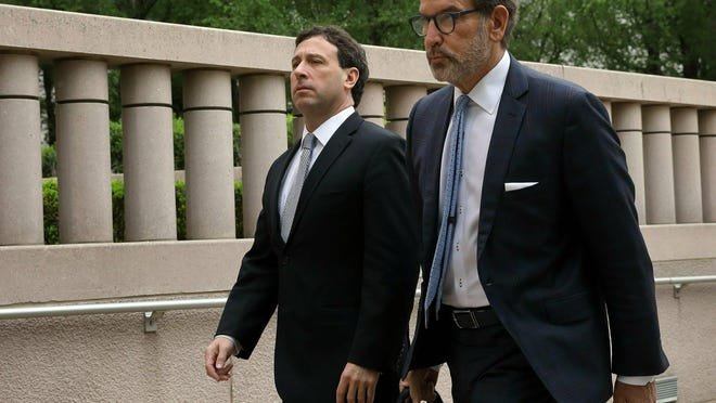 Former St. Louis County Executive Steve Stenger, left, arrives at federal court with his lawyer, Scott Rosenblum, on Friday in St. Louis.