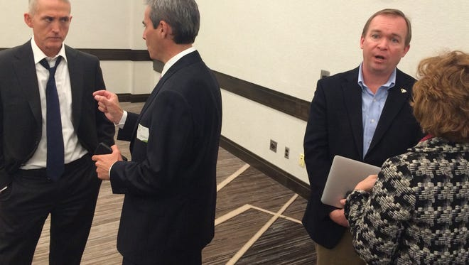 U.S. Rep. Trey Gowdy of Spartanburg, far left, and U.S. Rep. Mick Mulvaney of Indian Land, second from right, talk to attendees following their talk at a Greenville Chamber lunch Friday.