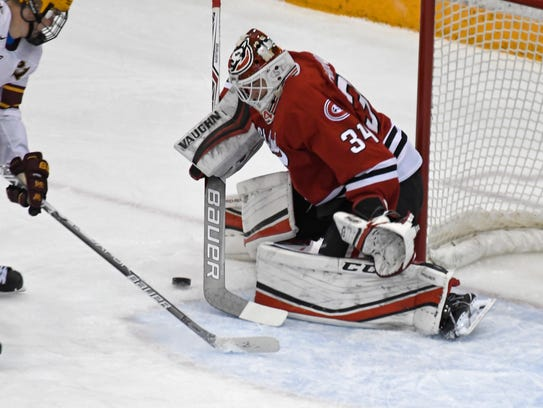 St. Cloud State goaltender David Hrenak plays the puck during a game at 3M Arena at Mariucci in Minneapolis on Jan. 7, 2018.