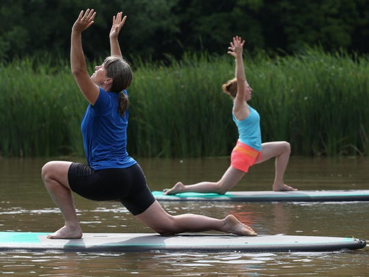 Teresa Sukiennicki and instructor Sherry Kessler during yoga class on the backwaters of Irondequoit Bay.