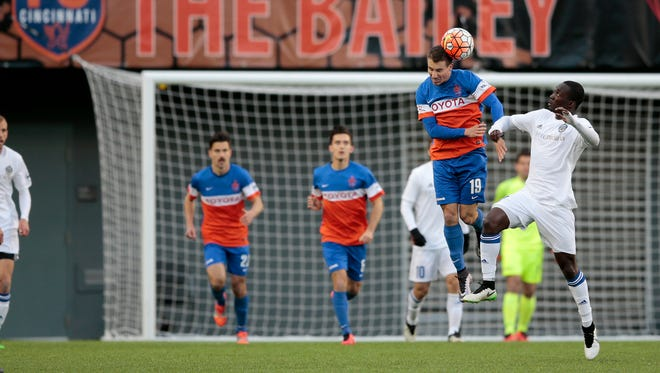 FC Cincinnati's Corben Bone clears the ball forward in the first half of an April 9 game at Nippert Stadium.