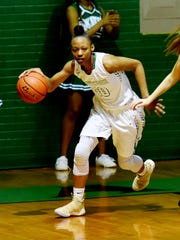 Bossier's Destiny Thomas dribbles up court during their