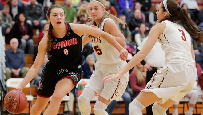 Seymour's Hailey Oskey (0) dribbles along the baseline against Luxemburg-Casco during a Jan. 9 game.