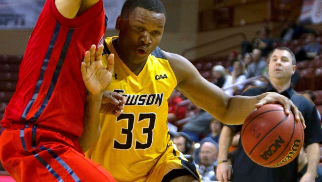 Towson's Eddie Keith II drives to the basket while being defended during a game last season.