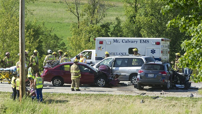 Mount Calvary EMS helps passengers of a three-vehicle crash on Highway 23 east of 7 Hills Road on Friday afternoon.