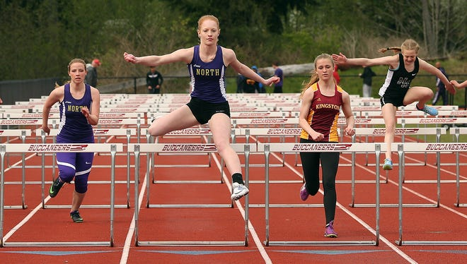 North Kitsap's Ashley Vest clears the last hurdle to take first place in the 100-meter hurdle race during a meet at Kingston High on Wednesday. Vest will compete Saturday at the Lil' Norway Invitational in Poulsbo.