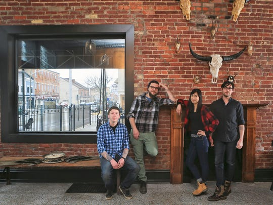 Gospel Bird is a new restaurant and bar opening on East Main Street in New Albany. The establishment's team includes, from left: Owner Eric Morris; Chef Ethan Ray, Matthew Farley, beverage manager and Karla Ortega, general manager.