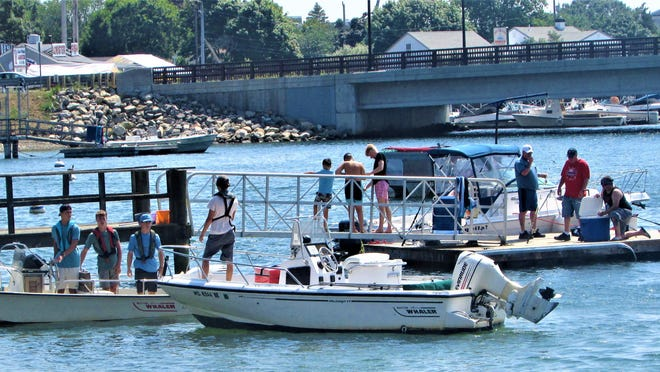 Boaters mixed with anglers during the August heat wave at the Electric Avenue Pier on Buttermilk Bay.