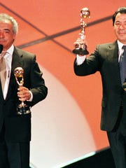 "Members of the Spanish duo ""Los Del Rio,"" Rafael Ruiz, left, and Antonio Romero Monge with their music awards for the World's best-selling latin group and the World's best-selling Spanish recording-artists, during the 1997 World Music Awards in Monaco. Their song ""The Macarena"" started a world-wide dance craze in 1996. (AP Photo/Lionel Cironneau, FIle)"