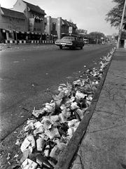 March 18, 1982 - Trash lines the curb after yesterday's Pub Crawl in front of Bombay Bicycle Club at Overton Square. The annual St. Patrick's Day pub crawl attracted thousands of people to Overton Square during its heyday in the late 1970s and early 1980s. (Dave Darnell/The Commercial Appeal)
