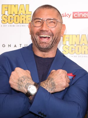 """Dave Bautista is all smiles at the World Premiere of """"Final Score"""" at Ham Yard Hotel, in London."""