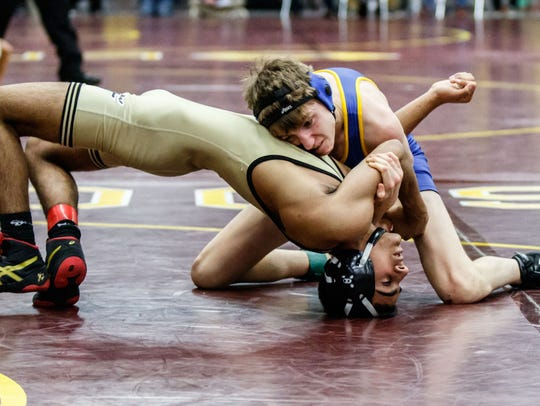 Mukwonago wrestler Josiah Lynden (top) grapples with
