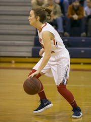Right: Creek Wood's Elayna Gass, who scored 13 points,
