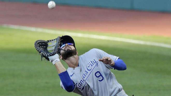 The Kansas City Royals' Ryan McBroom catches a fly ball hit by the Cleveland Indians' Domingo Santana in the second inning in Friday's season opener. McBroom is one of several fill-ins early in the season for the Royals as their roster starts to take shape.
