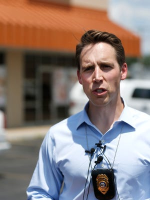 Missouri Attorney General Josh Hawley talks about authorities executing search warrants at 13 Asian massage parlors in Greene County on Thursday as part of a human trafficking and prostitution investigation.