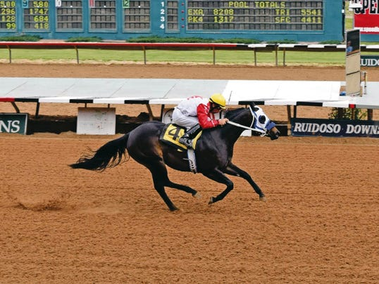 Lilly Is First is seen here winning the trials for the Mountain Top New Mexico-Bred Futurity at Ruidoso Downs.