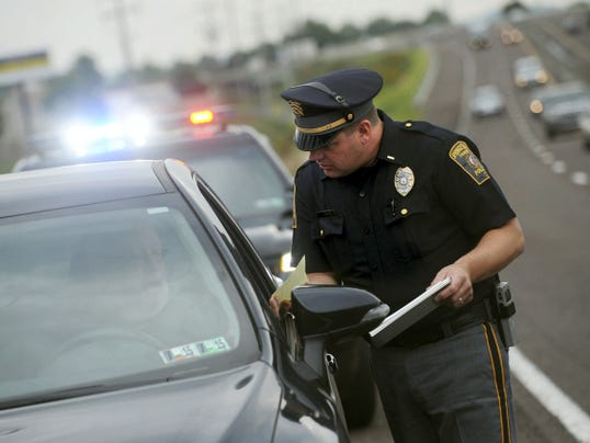 Lt. Todd King, with the Springettsbury Police Department, issues a moving violation citation to a driver who failed to move over to the left lane while another officer had someone pulled over on Route 30 in this file photo from last year. Springettsbury Township Police, Hellam Township Police and Northern York County Regional Police worked together to stop aggressive driving along Route 30.