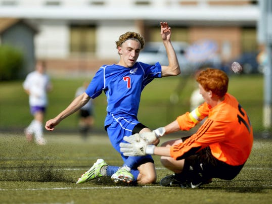 Spring Grove's Brant Aughenbaugh drives the ball past Lancaster Catholic goalkeeper Michael Jarvie in the second half of the championship game during the 6th annual York Suburban Soccer Tournament on Saturday.