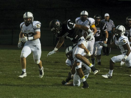 South Western's Noah Staub, center, gets taken down by the Cedar Cliff defense during Friday night's game at South Western High School. Staub finished with five catches for 85 yards, but Cedar Cliff won, 42-14.
