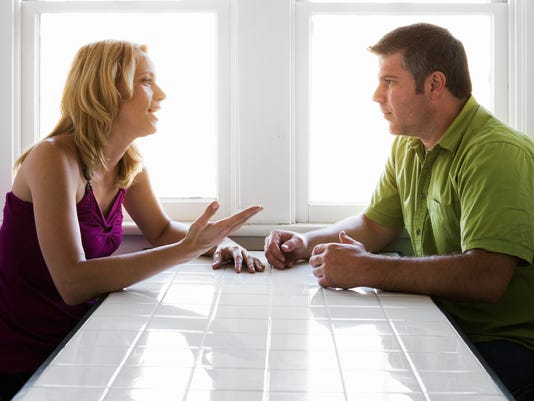 Couple Talking at Kitchen Table