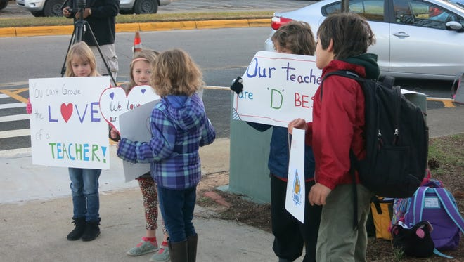 Children join parents in their protest against school grades in front of Hartsfield Elementary School.