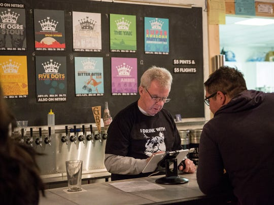 Patrons drink craft beer at The Guardian Brewing Company, located at 2100 W. White River Blvd.