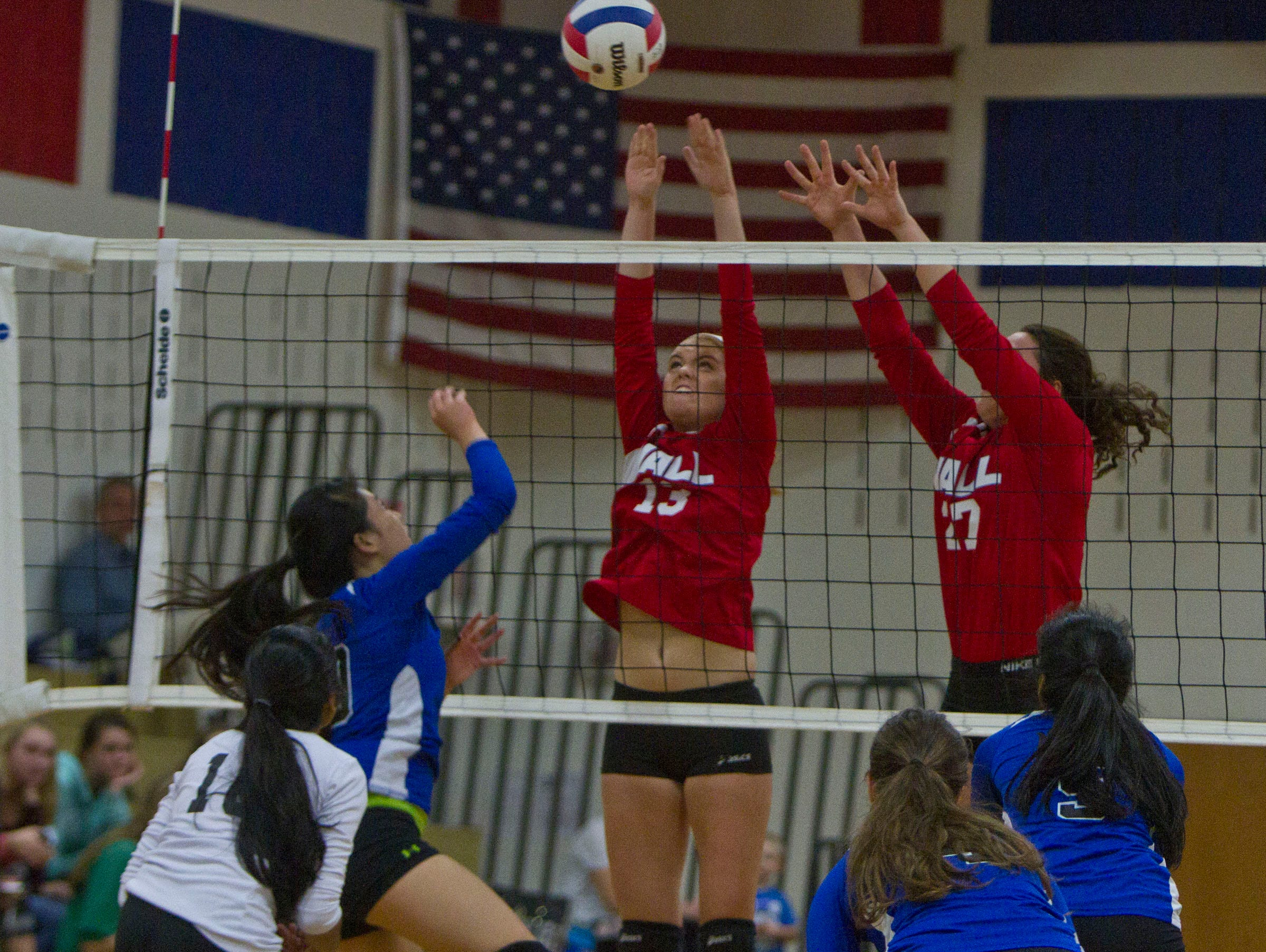 Wall's Regan Murphy (13) and Colleen Brennan block a shot. NJSIAA volleyball match between Wall and West Windsor Plainsboro North. Wall Township, NJ Wednesday, November 4, 2015 @dhoodhood