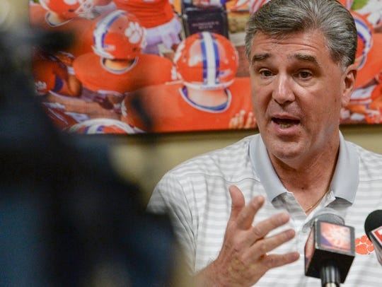 Clemson Athletic Director Dan Radakovich talks to media