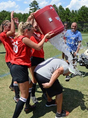 CESA coach Jeff Haigler is doused with ice water after his team defeated North Carolina's 96 TFCA Alliance 2-0 in the final of the U19 Girls division of the US Youth Soccer Region III Championships at the MeSA Soccer Complex in Greer  Wednesday.