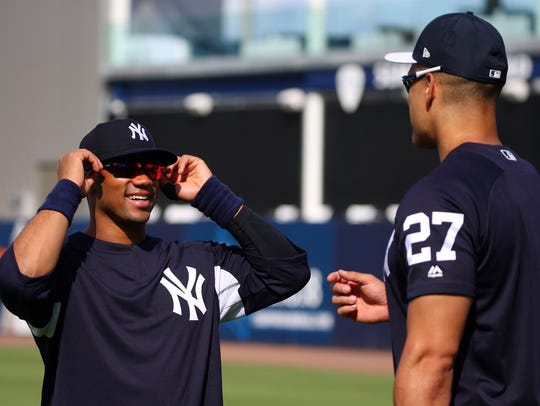 Russell Wilson cahts with Yankees outfielder Giancarlo