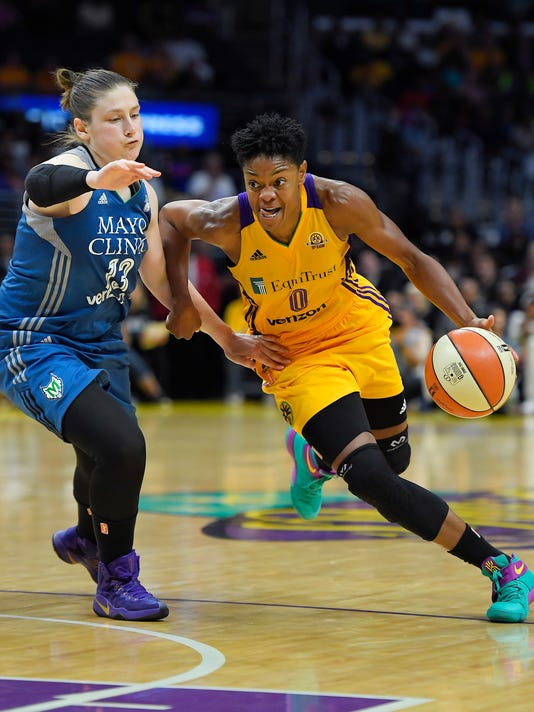 Los Angeles Sparks guard Alana Beard, right, drives past Minnesota Lynx guard Lindsay Whalen during the second half in Game 4 of the WNBA basketball finals, Sunday, Oct. 16, 2016, in Los Angeles. The Lynx won 85-79. (AP Photo/Mark J. Terrill)