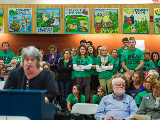 Teachers and their supporters listen to speakers during the public comment portion of a meeting of the Burlington School Board in Burlington on Thursday, October 13, 2016.