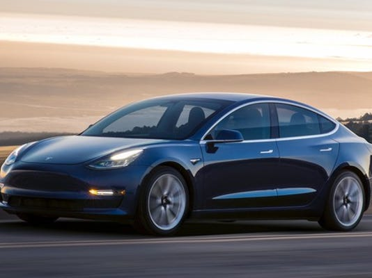 tesla-model-3-blue-driving_large.jpg