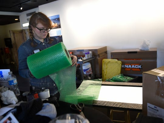 Lily Restenberger packs up a mirror at the Belcourt Theatre as the theater prepares for a six-month renovation project Monday, Dec. 28, 2015, in Nashville.