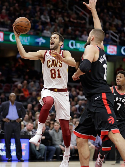Cleveland Cavaliers' Jose Calderon (81) drives to the basket against Toronto Raptors' Jonas Valanciunas (17) during the first half of an NBA basketball game Tuesday, April 3, 2018, in Cleveland. (AP Photo/Tony Dejak)