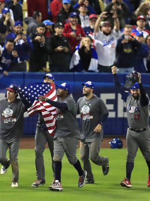 Team USA celebrates its title-game conquest of Puerto Rico at Dodger Stadium.