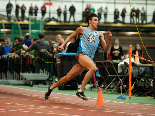 South Burlington's Ryan Steele competes in the 4x200m relay race during the high school indoor track and field championships at Gutterson Field House on Saturday February 10, 2018 in Burlington.