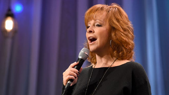 "Reba McEntire performs at the telethon for ""Dolly Parton's Smoky Mountains Rise: A Benefit for the My People Fund"" on Dec. 13, 2016, in Nashville."