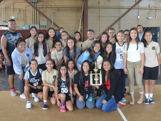 The Untalan Middle School Wildcats were presented with a trophy for winning the Guam Interscholastic Sports Association Girls' Basketball League championship in their gym on Friday, June 5, 2015. The Warriors were co-champions with the Benavente Middle School Roadrunners. Untalan won eight total championships during the 2014-2015 school year, including all six girls' sports, and were the GISA overall champions.