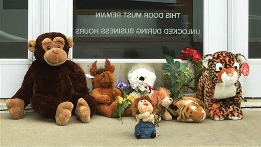 """Stuffed animals adorn the doorstep of Dr. Walter Palmer's River Bluff Dental office in Bloomington, Minn., Tuesday, July 28, 2015. Palmer, accused of illegally killing a protected lion in Zimbabwe, said Tuesday that he thought everything about his trip was legal and wasn't aware of the animal's status """"until the end of the hunt."""""""