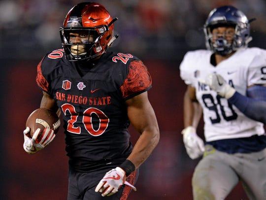 San Diego State running back Rashaad Penny runs for