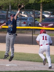 Battle Creek Bombers' Brennon Lund reaches first base on an error in Monday's game against the Kalamazoo Growlers.
