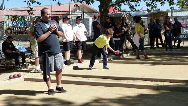 People gather at the bocce ball courts at South City Park for Paesano Days.