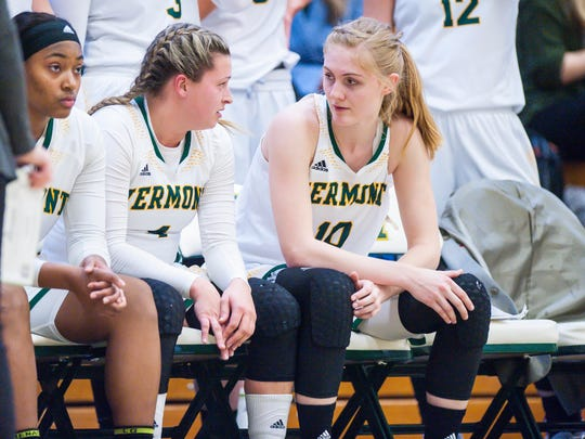 The University of Vermont's Hayley Robertson, left, speaks with Hanna Crymble on the bench during a break in the game against Binghamton University in Burlington on Wednesday, January 31, 2018.